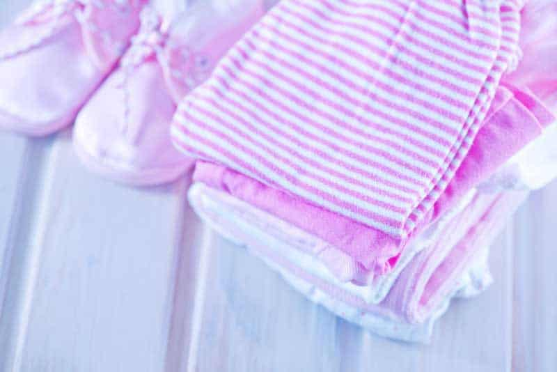 folded baby clothes--things to do to get organized before baby comes