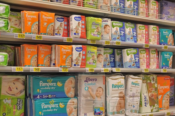 different brands of diapers in aisle at supermarket