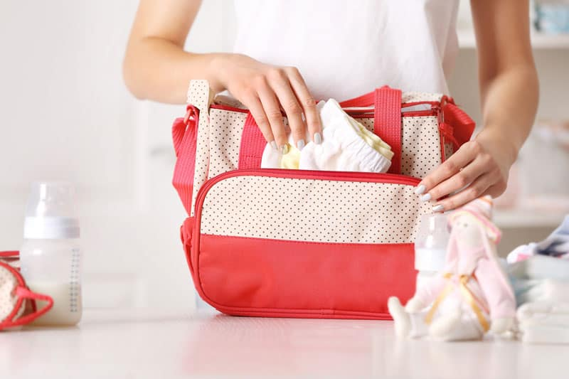 new mom packing her diaper bag