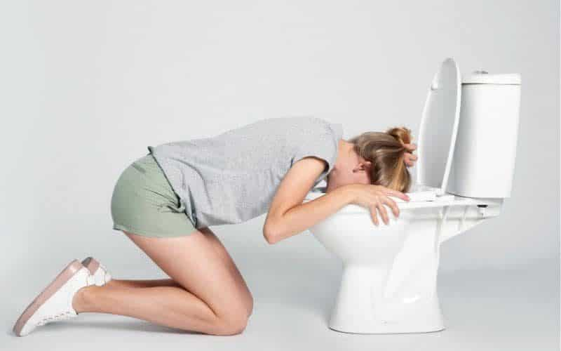 morning sickness cures for sick pregnant woman with head in the toilet