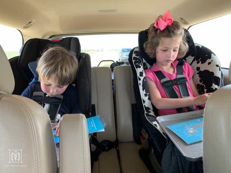 kids playing games on road trip